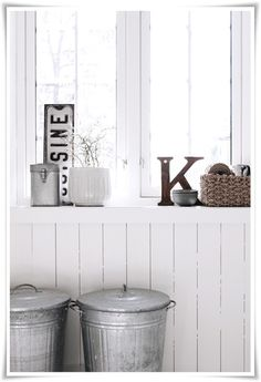 Vintage metal trash cans in use as beautiful storage. Find our similar vintage trash can here: http://shop.metaloffmain.com/page/product/192.html