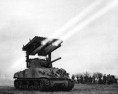 """The Rocket Launcher T34 (Calliope) was a tank-mounted multiple rocket launcher used by the US Army during WW2. The launcher was placed atop the Medium Tank M4, and fired a barrage of 4.5 in (114 mm) M8 rockets from 60 launch tubes. It was developed in 1943; small numbers were produced and were used by various US armor units in 1944-45. It adopts its name from the musical instrument """"Calliope"""", also known as the steam organ, which had similarly lined pipes."""