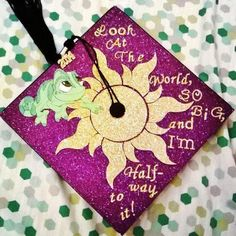 My Rapunzel themed graduation cap from my associates degree ceremony! I was half way to my bachelors! I love doing Disney caps!
