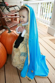 This little one is adorable, and I love you costume.  Maybe we will have a little Our Lady of Guadalupe for all saints next year!  So cute.