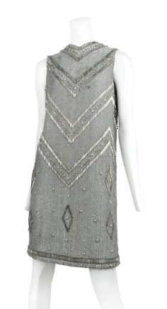 www.resurrectionvintage.com Loris Azzaro SILVER BEADED MINI DRESS Silver bead encrusted shift dress with chevron bugle bead detail and back zip closure