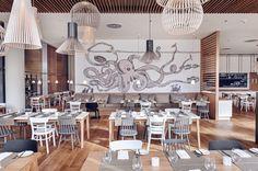 Pared decorada con dibujo de pulpo the-life-aquatic-antique-mera-hotel