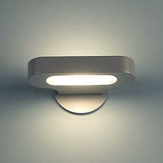 Talo 21 Mini Wall Sconce by Artemide at Lumens.com, comes in white, 1.25x8x4deep; halogen, 330.; led is 530.