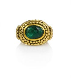 """An Art Deco gold and cabochon emerald """"Bague Egyptienne"""" ring in the ancient style with granulated decoration, in 18k. Inscribed and Dated: December 4, 1923-December 4, 1933. Rene Boivin, France, with certificate."""