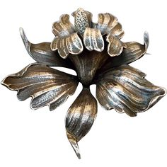 Gorgeous, hard to find, large, sterling figural brooch, By Cini, a  figural orchid, of solid sterling dating from between 1922 to 1949. Must have for