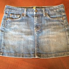 7 for all mankind denim jean mini skirt laying flat measurements,  waist 15 1/2, hips 17, length 12in no holes or tears or stains 7 for all Mankind Skirts Mini