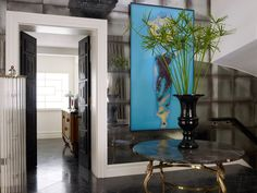 In the elegant marble-floored hallway the custom-made doors were inspired by the facade of a Neopolitan church and the walls are lined in mercury-glass panels