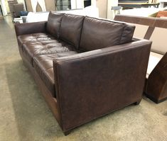 Customers love our Arizona, and it's easy to see why.  All of the same great specs we use in all of our furniture, but the Arizona features tufted seat cushions. The cover shown here is Italian Berkshire Cocoa Leather. Just like Italian Brompton Cocoa but without the extra step of wax impregnation that makes Brompton shiny. https://www.leathergroups.com/blog/arizona-leather-sofa-in-italian-berkshire-cocoa-leather-96l-x-39d