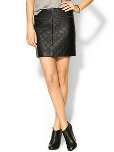 Tinley Road Quilted Vegan Leather Skirt   Need a little rock star glamour in your wardrobe? The two front zipper pockets add just the right amount of metallic shine to this matte black skirt, while the quilted stitching creates a fun textured element. We love this skirt worn casually with booties, a graphic tee, and layered necklaces, or dressed up with a fitted long sleeved black blouse, tall leather heeled boots, long black wool coat, and python print handbag for a chic and timeless look.