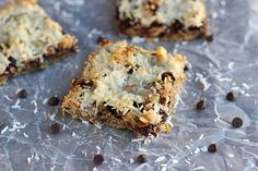 Healthy Seven-Layer Bars -¾ c. oat flour ¼ t. sea salt ½ t. cinnamon 2 T. olive or (melted) coconut oil 1 t. maple syrup ½ t. vanilla 1-3 T. cold water, as needed FILLINGS: -chopped dark or unsweetened chocolate (about 3-4 tablespoons) -raisins or dried apricots (about 2 tablespoons) -walnuts or pumpkin seeds (about 2 tablespoons) -one batch of my condensed milk recipe (see link in Notes) -grated, unsweetened coconut (3-4 tablespoons)