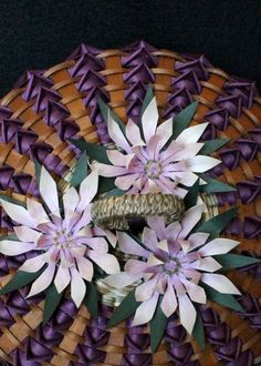 Lotus flowers on a sweetgrass and black ash basket. Made by mohawk basket maker, Ann Mitchell.
