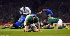 Ireland star Sexton doubles over in pain after appearing to pick up a groin injuries while attempting to kick long