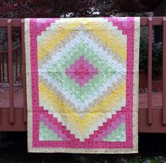 Lap Quilt in a colorful assortment of fabric by WarmandCozyQuilts, $295.00