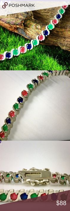 """Genuine Multicolor Gemstones Tennis Bracelet SALE 🎈🎉5.00ctw Genuine Multicolor Gemstones, 14k White Gold Filled Tennis Bracelet . Contains 5.00ctw Genuine Blue Sapphire, Ruby and Emerald. Total weight is 12.6 grams, 7"""" long                                     BUNDLE AND SAVE 🎉🎈👍 Jewelry Bracelets"""