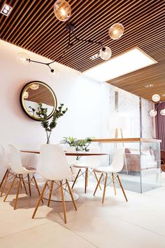 Image 11 of 33 from gallery of Pinwhell House / CEEarch. Photograph by VietLu Wood Ceilings, Three Floor, Ho Chi Minh City, Apartment Interior, Flooring, Dining Tables, Dining Rooms, House, Furniture