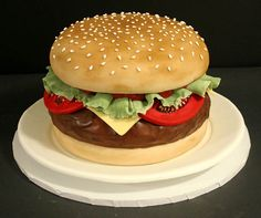 Hot off the grill! This detailed cheeseburger groom's cake is bound to make mouths water.