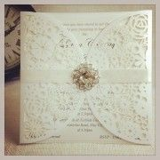 This is such a classy way to decorate your invitations. The laser cut lace patterned outer pocket secured with a satin band and brooch make these invites look entirely elegant! Laser Cut Wedding Invitations, Invites, Paper Lace, Winter Theme, Color Card, Dream Wedding, Wedding Dreams, Laser Cutting, Stationery