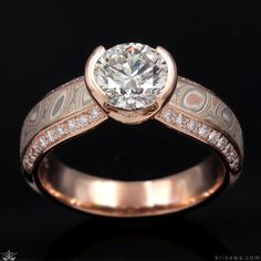 This mokume engagement ring has a silhouette of paved diamonds. The center stone is set into a rolled semi-bezel. Handcrafted in 14k rose gold and Champagne Mokume, this ring features a 1.70ct round diamond center stone. Luxury Engagement Rings, Thing 1, Right Hand Rings, Jewelry Photography, Brilliant Diamond, Stone Rings, Round Diamonds, Heart Ring, Jewelery