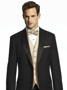 Black three piece Tuxedo with champagne vest and bow tie