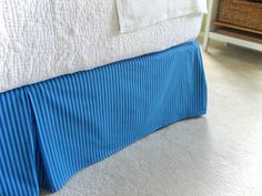 Sew your own bedskirt...sounds fairly straightforward!  Her blog has several simple projects