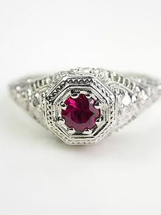 Antique Ruby Ring with Floral and Filigree, this looks a lot like my grandma's wedding ring that I now have!