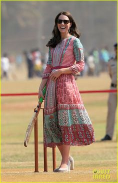 The Duchess of Cambridge showed off her sporty side on the first day of her official tour of India and Bhutan, kicking off her second engagement of the day with a round of cricket. She is wearing a colorful customized dress by Indian designer Anita Dongre and tal wedges. Mumbai, India, April 2016