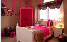 Girls Leopard & Pink room,  Like the curtain and wall decor