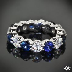 Full of color, this custom Sapphire and Diamond Wedding Band begs to be seen. The radiant blue sapphires (7 x .15ct in sapphires) alternate with beautiful round-ideal diamonds (.8 x .35ct in diamonds) to create this show stopping ring