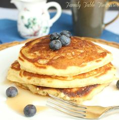 An Easy Fluffy Pancake Recipe from Scratch?! Yup! Say good bye to the box mix! This recipe taste way better and just uses a few simple ingredients!