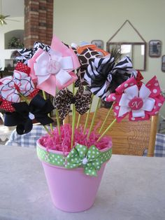 flower pot bow holder. paint a pot and add painted sticks to clip flowers to