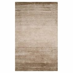 Anchor your dining set or living room seating group in classic style with this hand-woven art silk and cotton rug, featuring a champagne hue.  ...