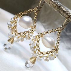 Pearls and moonstones combine to create these shimmery wedding chandelier earrings -  See them in video on my Instagram page!!