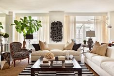 Design: Bick Simonato  I like many of the choices made for this room...I should consider the Black/Khaki Pillow Colors for my Crème Sectional...