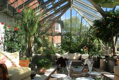 Built in planters, and over size pots make this conservatory a real plant - and people - haven. www.alitex.co.uk