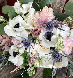 Stunning bouquet with white anemone, blush roses and astilbe and blue eryngium