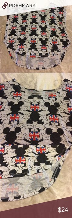 Disneyland Mickey Mouse Great Britain Flag Shirt S Cute cute cute!!! Disneyland Walt Disney World Mickey Mouse Sleeveless tee. Mickey has a Great Britain Flag on his bottom. Shirt is a small. Mickey's are all over the front and back. Excellent condition.  Chest is 22 inches. High Low with the front length being 22 inches.  I love to bundle.  Bin Z Disney Tops Tees - Short Sleeve