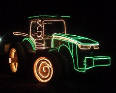 My husband and I decorated one of our John Deere tractors last winter 2012. Going to try to top that this coming winter!