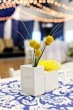 Contemporary Yellow Centerpiece. Photography by Kelly Braman. Flowers by Modern Day Floral and Events.
