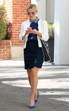 Reese Witherspoon makes business as usual seem beyond chic – check out her scalloped white blazer, blue suede pumps and matte round sunnies with flash lenses!