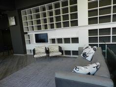 Libreria LEMA Selecta, divano, poltroncine e tappeto LIVING Divani
