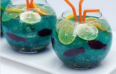 ADULT fish Bowl punch  10 ounces vodka 10 ounces coconut rum 6 ounces Blue…