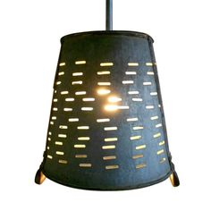 "Pendant Light made from vented galvanized bucket used to collect olives in Turkey. Includes 18"" galvanized steel hanging rod and grounded socket for hard wiring. Light pools softly beneath, also illuminates vents in striking patterns while handles are caught in suspension.This may be purchased on ecofirstart.com"