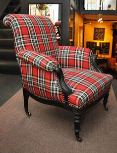 French, 19th century Napoleon III Ebonized Bergeres chair with red Tartan upholstery and nailhead Trim.
