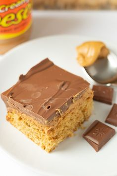 Chocolate peanut butter tray bake is a fantastic recipe to serve up at parties or as a special treat. The sponge cake is baked, covered in delicious peanut butter and then smothered in smooth milk chocolate. This is one of the best chocolate tray bakes you will ever try! #neilshealthymeals #chocolatetraybake #peanutbuttertraybake #chocolatepeanutbuttertraybake #baking #chocolatecake