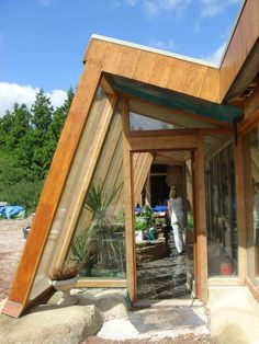 Brighton_Earthship_entrance - Passive solar/greenhouse Facade that could perhaps be added to an ordinary home. (Don't like the funky angles, but this is the beginning of the right idea.)