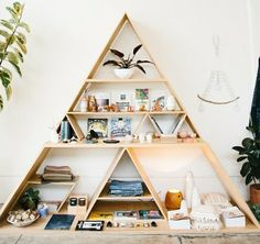 triangle shelf unit made out of plywood, found at http://blog.madewell.com/2014/04/19/show-tell-hannah-henderson-of-general-store/ (no instructions but looks like it's probably easy to diy)