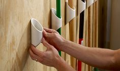 Mount a PVC pipe to keep tall items upright and organized in the garage. Click through for a step by step project plan!