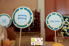 Yellow and blue wedding candy buffet with DIY signs anchored in lemons.  http://destinationcreate.com #wedding#yellow