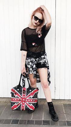 Sunglasses with translucent top, black bralette, denim shorts, flannel plaid shirt & combat boots by maridevogeski
