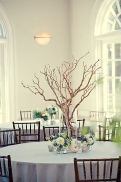 Find Inspiration In Nature For Your Wedding Centerpieces - 40 Creative Ideas It would be awesome to be able to bring nature inside and to have actual trees there but you can have the next best thing: a tree centerpiece made with branches. Select branches with interesting shaped and arrange them in a glass cylinder.{image by Threaded Together}.